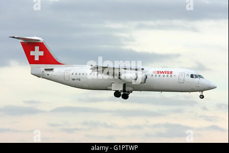 Swiss International Air Lines, British Aerospace Avro 146-RJ100. Photographed at Malpensa airport, Milan, Italy - Stock Photo