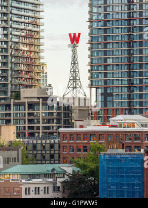 Revolving 'W' sign on historic Woodwards Building in downtown Vancouver. Building was demolished in 2006 but sign - Stock Photo