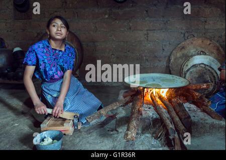 Indian woman baking tortillas. Chiapas, Mexico - Stock Photo