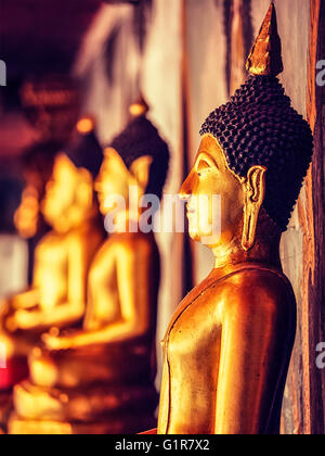 Buddha statues in Buddhist temple, Thailand - Stock Photo