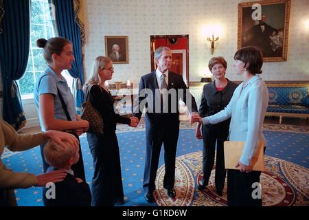 U.S President George W. Bush holds hands with family members of victims of United Flight 93 in the Blue Room of - Stock Photo