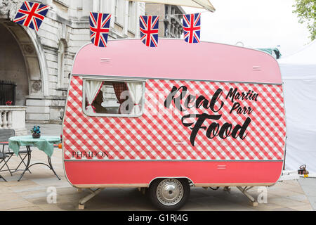 London, UK. 18 May 2016. Pictured: Photographer Martin Parr inside his Real Food caravan. Photo London, the largest ever photography event to take place in the UK, opens at Somerset House on 19 May and runs until 22 May 2016. Photo London will present 85 of the world's leading galleries showcasing work of the most important photographers from the earliest days to the present. Photojournalist Don McCullin is this year's Photo London Master of Photography. Stock Photo