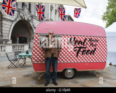 London, UK. 18 May 2016. Pictured: Photographer Martin Parr with his Real Food caravan. Photo London, the largest ever photography event to take place in the UK, opens at Somerset House on 19 May and runs until 22 May 2016. Photo London will present 85 of the world's leading galleries showcasing work of the most important photographers from the earliest days to the present. Photojournalist Don McCullin is this year's Photo London Master of Photography. Stock Photo