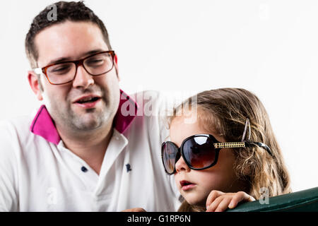 little daughter plays the Star role talking to her manager about what to do - Stock Photo