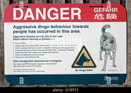 Sign, warning, danger of Dingo (Canis lupus dingo), Fraser Island, Great Sandy National Park, Queensland, Australia - Stock Photo
