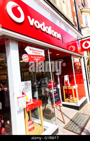 Vodafone mobile phone phones shop store sign building exterior name smartphone cities British chain brand Lincoln - Stock Photo