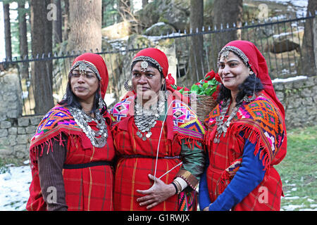 Manali, India: Adult women dressed in the traditional tribal attire, pattoo, of Kullu valley in the Himalayan mountain - Stock Photo