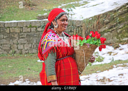 Manali, India: Adult woman dressed in the traditional tribal attire, pattoo, of Kullu valley in the Himalayan mountain - Stock Photo