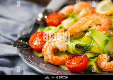 Prawns, zucchini noodles and tomato - delicious healthy food - Stock Photo