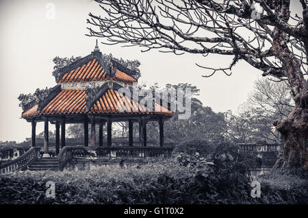Ancient vietnamese temple with dragons on top - Stock Photo