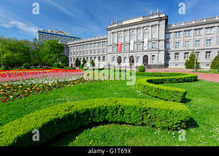 Mimara museum in Zagreb down town with flowers in front and hotel Westin on the back. - Stock Photo