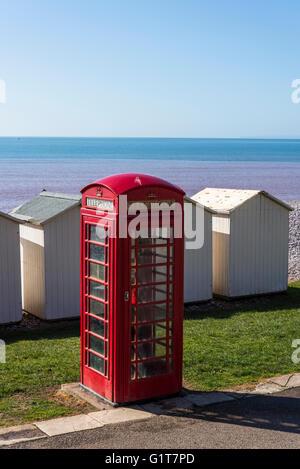 Red telephone box, Budleigh Salterton beach, East Devon, England, United Kingdom - Stock Photo