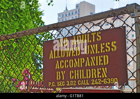 San Francisco, California, Usa: an ironic sign on a gate of a children playground - Stock Photo