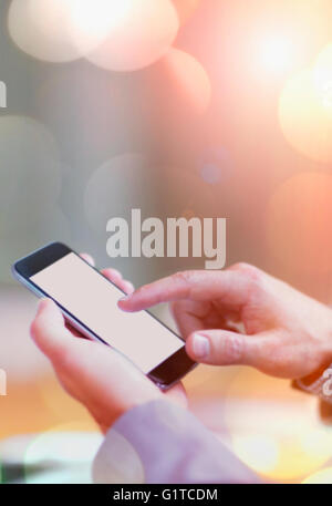 Close up of businessman dialing cell phone - Stock Photo