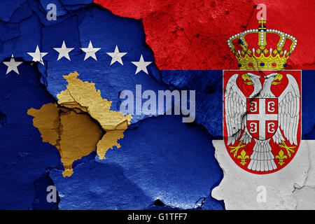 flags of Kosovo and Serbia painted on cracked wall - Stock Photo