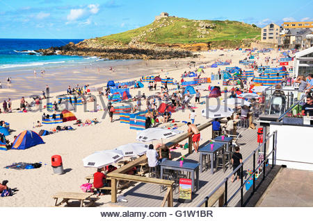 Porthmeor beach with bars and cafes in summer, St Ives, Cornwall, UK - Stock Photo