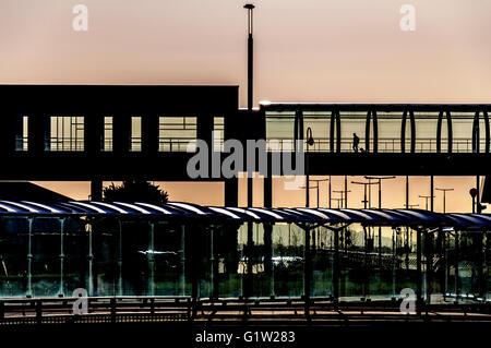Lone passenger graphic architecture, Dublin Airport, Terminal Two, Ireland - Stock Photo