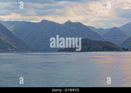 Villa del Balbianello in the distance on Lake Como Italy - Stock Photo