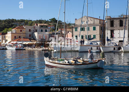 Fishing boat passing, Gaios harbour, Paxos, Ionian Islands, Greece - Stock Photo