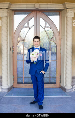 Stylish bride in a blue suit - Stock Photo