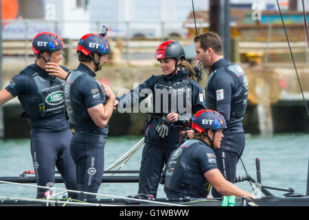 The Duchess of Cambridge and Sir Ben Ainslie on board the America's Cup catamaran at Portsmouth, UK on 20th May - Stock Photo