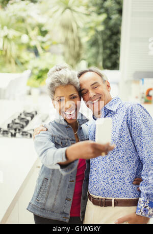 Enthusiastic mature couple taking selfie - Stock Photo
