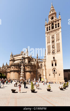 La Giralda, bell tower of Seville Cathedral at the Plaza del Triunfo, Seville, Spain - Stock Photo