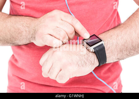 Close-up of athlete showing time on wristwatch - Stock Photo