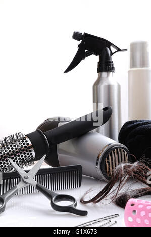 Vertical composition hairdressing tools on a white table and white background isolated - Stock Photo