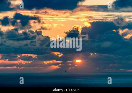 Evening mood, dramatic cloudy sky at sunset over the sea, San Sebastian, Donostia, Basque Country, Spain - Stock Photo