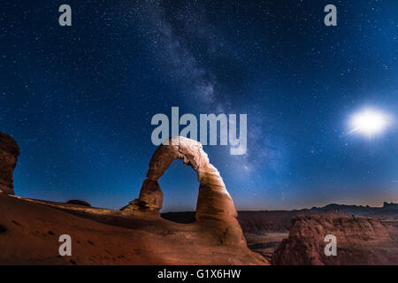 Natural Arch Delicate Arch with Milky Way at night, Arches National Park, Moab, Utah, USA - Stock Photo
