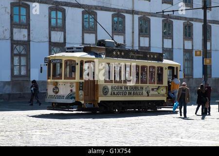 Old tram in the historic centre, Porto, Portugal - Stock Photo