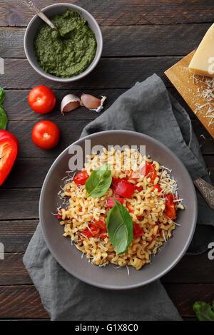 vegetarian pasta with avocado pesto, food top view - Stock Photo