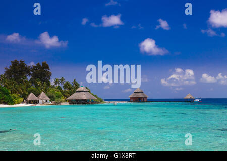 Over water bungalows with steps into amazing green lagoon - Stock Photo