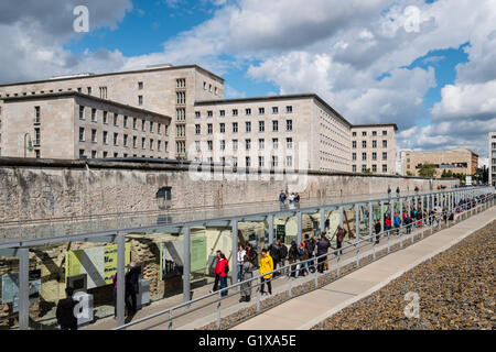 View of tourists visiting outdoor museum at Topography of Terror former Gestapo headquarters in Berlin Germany - Stock Photo