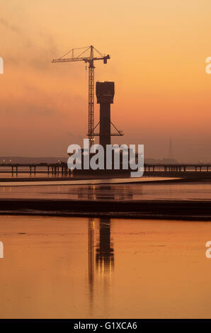 Sunrise over the Mersey Gateway Bridge currently being built to span the River Mersey between Runcorn and Widnes. - Stock Photo