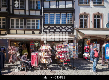 Handicapped woman with electric wheelchair shopping for souvenirs, Strasbourg, Alsace, France, Europe - Stock Photo