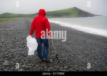 Aberystwyth Wales UK, Saturday 21 May 2016  UK weather:  A  hardy volunteer comes out in the rain on a wet and miserable - Stock Photo