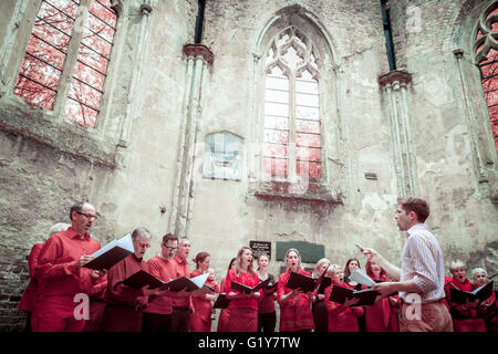 London, UK. 21st May, 2016. Choir performs in the ruined Nunhead Chapel. Nunhead Cemetery Annual Open Day. Photographed - Stock Photo