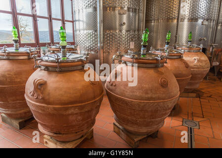 fermentation of red wine 'Dino' in amphora in Tuscan winery Fontodi, Panzano (Greve in Chianti) - Stock Photo
