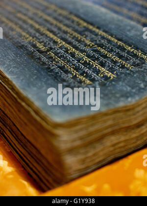 An ancient Tibetan Buddhist text from the 12th century. - Stock Photo