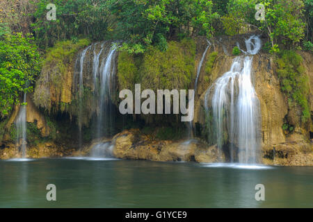 Sai Yok waterfall in  Thailand between winter. - Stock Photo