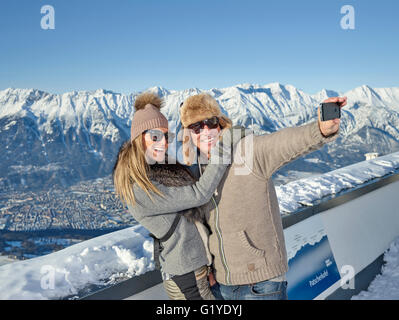Couple photographing, making a selfie in front of mountain scenery, Patscherkofel, Patsch, Inntal chain, Innsbruck, - Stock Photo