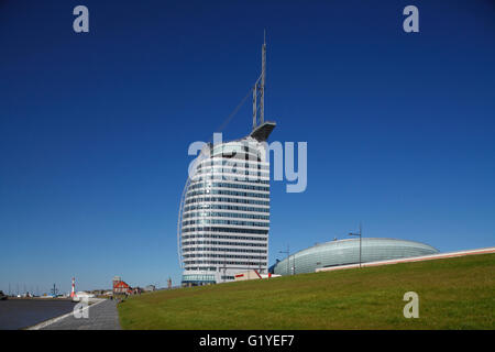 Embankment promenade with air house and Atlantic Sail City Hotel Havenwelten, Bremerhaven, Bremen, Germany - Stock Photo
