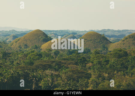 View of the famous and unusual Chocolate Hills in Bohol, Philippines - Stock Photo