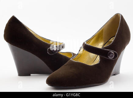 Pair of female brown velvet wedge heel shoes isolated on white - Stock Photo