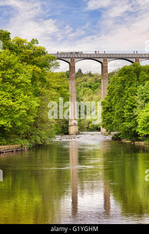 Pontcysyllte Aqueduct, built by Thomas Telford, and a World Heritage Site, reflecting in the River Dee, with a narrowboat - Stock Photo