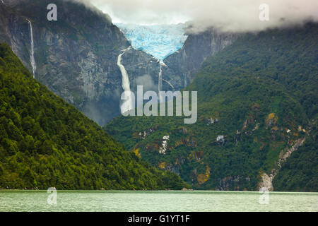 scenic view on glacier ventisquero calgante with waterfall and lake in chilean patagonia on the road Carretera austral - Stock Photo