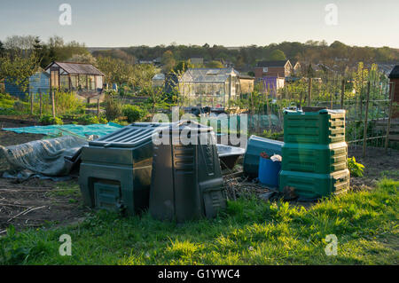 Burley in Wharfedale, West Yorkshire, England - allotments with compost bins (different sizes and shapes) and greenhouses. - Stock Photo