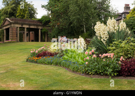 Flower garden, building and sitting bench. Smith Gardens, Oakwood ...